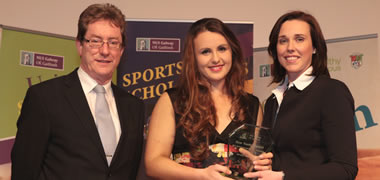 Aifric Keogh from Furbo, Co. Galway receives the Tom Tuohy Memorial Award for Outstanding Achievement in Rowing from Deirdre Tuohy and NUI Galway President, Dr Jim Browne at the Annual NUI Galway Sports Awards.