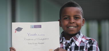 Nine year old Tony Evans Wanjau from St Patrick's Primary School, Galway, receiving his certificate on completion of the Youth Academy at NUI Galway.