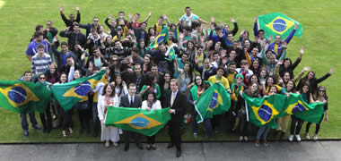 At NUI Galway were over 100 Brazilian students with (front row, l-r): Anna Cunningham, Director of International Affairs, NUI Galway; Dr Brian Hughes, Dean of International Affairs, NUI Galway; Elza Moreira Marcelino de Castro, Brazilian Deputy Ambassador, Minister-Counselor, Chief of Chancery; and Dr Jim Browne, NUI Galway President.