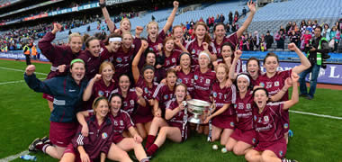 The Galway Senior Camogie team celebrate with the O'Duffy Cup after being crowned 2013 All-Ireland Senior Camogie Champions.