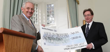 Pictured is Chairman of Cancer Care West, John McNamara presenting the cheque for €1 million to President of NUI Galway, Dr Jim Browne