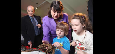 Commisioner Geoghegan-Quinn engages with young visitors to Sea2Sky, organised by NUI Galway to celebrate European Researcher's Night. Also pictured is NUI Galway's Dr Andy Shearer.