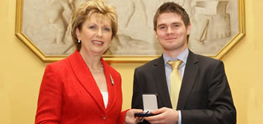 President of Ireland, Mary McAleese with NUI Galway student Trevor Glavey