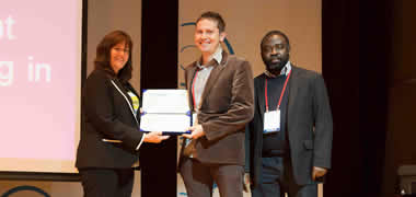 INSIGHT's Lukasz Porwol and Dr Adegboyega Ojo accept the 'Best Paper Award for Completed Research' from Jeanne HOLM, ICEGOV Program Co-Chair.