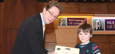 NUI Galway President, Dr Jim Browne presents Peter Donlon from Garrafrauns National School, Tuam, Co. Galway with a Youth Academy Certificate at a special ceremony at the University recently.