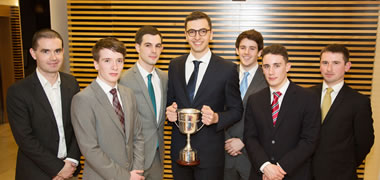 Pictured with the trophy are (from left): Cian Twomey, Lecturer in Financial Economics, NUI Galway and academic mentor; team members Sam Ryan, Shane O'Brien, Anthony Patrick Saoud, Oisín Kenny, and Conor Hanniffy; and John Stokes, NAMA/Department of Finance and industry mentor.