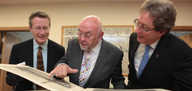 NUI Galway Librarian John Cox shows Minister Ruairí Quinn and NUI Galway President Dr Jim Browne some photographs of 19th century Connemara from the Arthur J. Balfour Album, a volume in the James Hardiman Library's special collections, housed in the new Hardiman Research Building. The Balfour Album of photographs was originally created in 1893-1895 by the Belfast photographer, Robert John Welch.