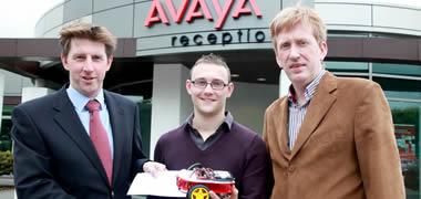 Dr Michael Keane, Avaya (left) presents the Avaya prize winners cheque to Kevin McGlinchey (centre). Also pictured is Kevin's project supervisor, Liam Kilmartin (right) from the Electronic Engineering discipline at NUI Galway.q
