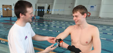 NUI Galway student and Sports Scholarship athlete Kevin McGlade with researcher Robert Mooney.