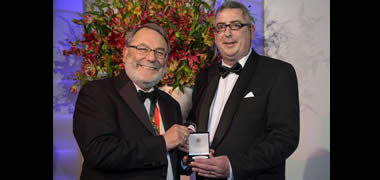 Colin O'Dowd, who is a Professor in the School of Physics and Director of the Ryan Institute's Centre for Climate & Air Pollution Studies, is pictured here (right) receiving the Appleton Medal from Institute of Physics President Sir Peter Knight.