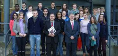 Pictured is Coca Cola Vice President and NUI Galway graduate Irial Finan with staff and students of the JE Cairnes School of Business and Economics, NUI Galway
